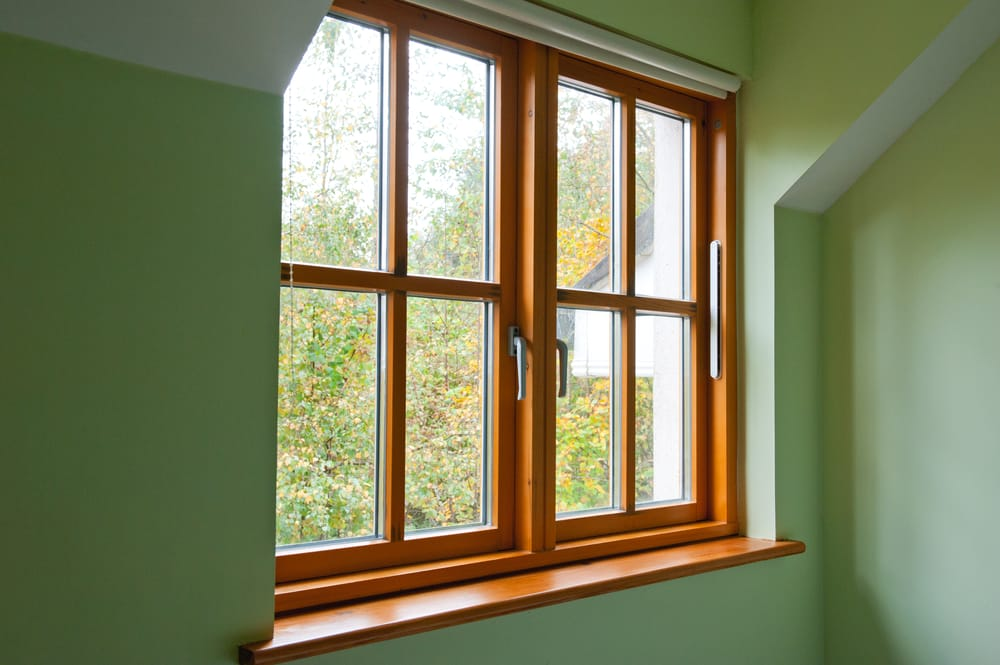 repairing or replacing wooden window frames